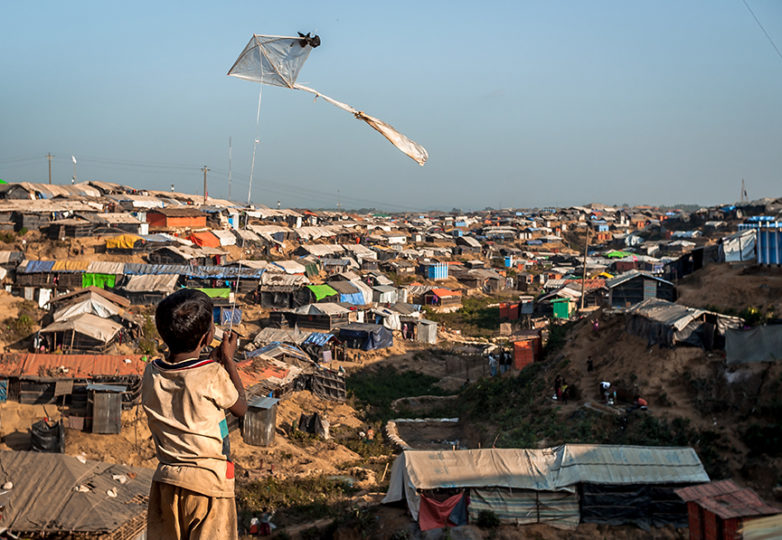 """I'm gonna be a pilot when I grow up,"" says a young boy on Dec. 25, 2017, as he flies a plastic bag kite over Kutupalong refugee camp in Bangladesh. Kutupalong is home to nearly one million Rohingya refugees. Photo: Mike Chen"