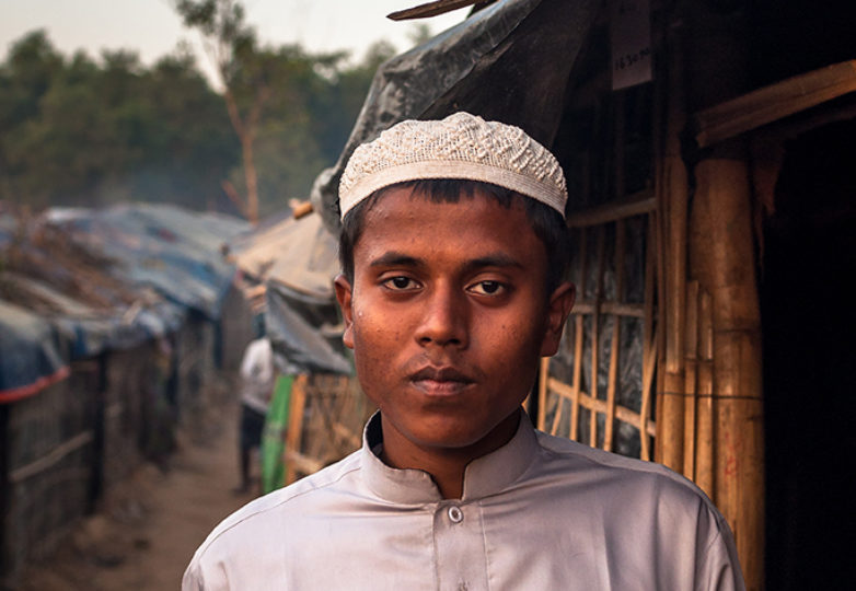 A Rohingya boy poses for a portrait  in traditional Islamic dress at Kutupalong Refugee Camp in Bangladesh on Dec. 17, 2017. In Buddhist majority Myanmar, Rohingya Muslims are considered illegal immigrants from neighboring Bangladesh, denied citizenship and rendered a stateless people. Photo: Mike Chen