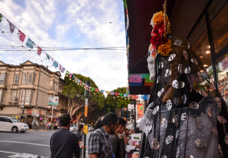 Vending tables attract visitors outside of Mixcoatl Arts & Gifts on 24th Street during Día de Muertos in San Francisco's Mission district, Friday November 2, 2018. Photo: Mabel Jiménez/Calle 24