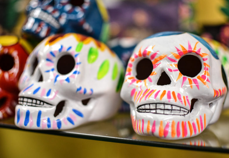 Merchandise is displayed inside Mixcoatl Arts & Gifts on 24th Street during Día de Muertos in San Francisco's Mission district, Friday November 2, 2018. Photo: Mabel Jiménez/Calle 24