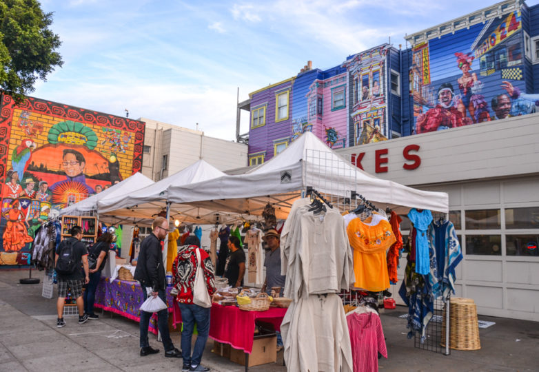 Vendor booths set up outside the House of Brakes on 24th Street during Día de Muertos in San Francisco's Mission district, Friday November 2, 2018. Photo: Mabel Jiménez/Calle 24