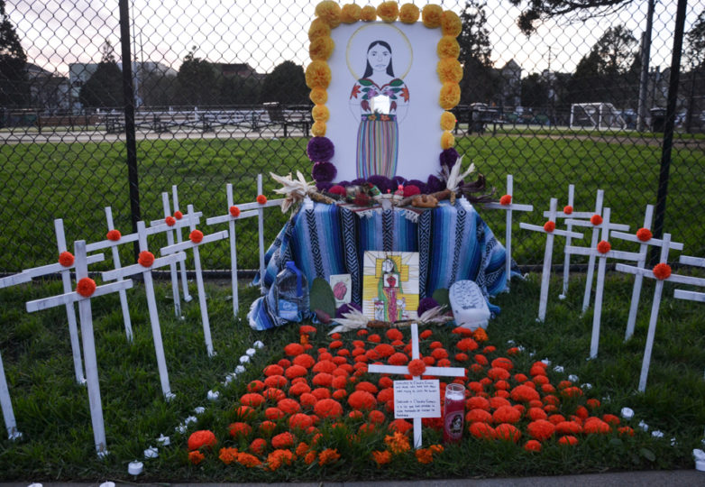 An altar dedicated to Guatemalan migrant Claudia Gomez, is observed by visitors at Garfield Park during Día de Muertos in San Francisco's Mission district, Friday November 2, 2018. Photo: Mabel Jiménez/Calle 24