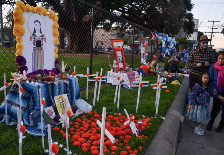 An altar dedicated to Guatemalan migrant Claudia Gomez, is observed by visitors at Garfield Park during Día de Muertos in San Francisco's Mission district, Friday November 2, 2018. Photo: Mabel Jiménez