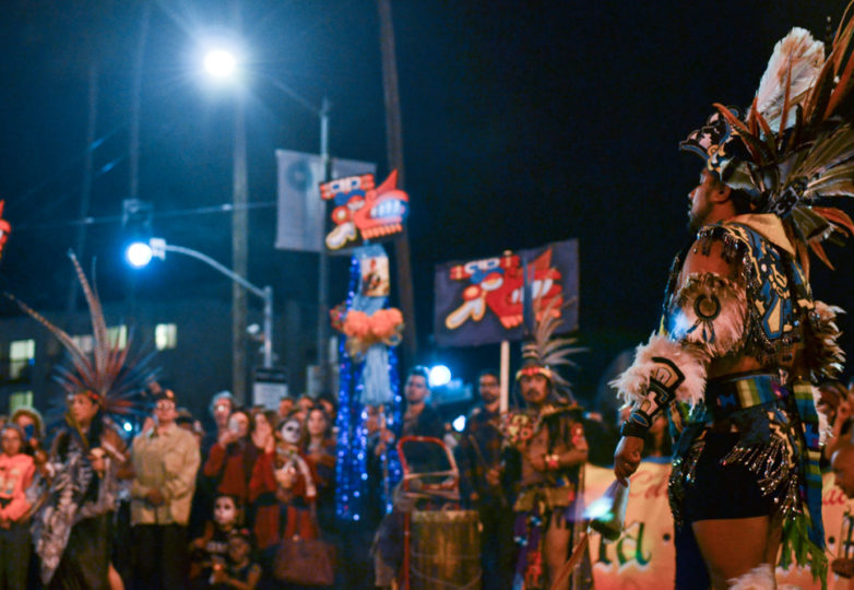 Aztec dancers perform a blessing on the corner of 24th and Mission streets during Dia de Muertos in San Francisco's Mission district, Friday November 2, 2018. Photo: Mabel Jiménez/Calle 24