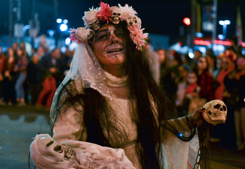 La Llorona cries for her hijos during the main procession on Dia de Muertos as it marches down Mission Street, San Francisco, on Friday November 2, 2018. Photo: Mabel Jiménez/Calle 24
