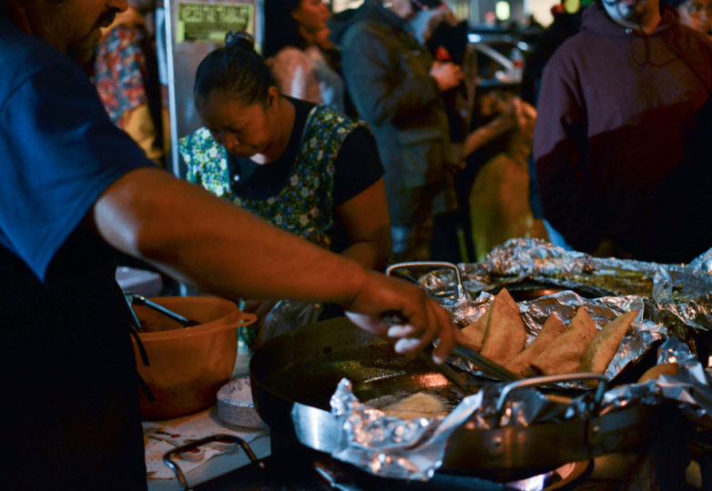 Vendors prepare food at the 24th Street BART Plaza during the Dia de Muertos celebrations in San Francisco's Mission district, Friday November 2, 2018. Photo: Mabel Jiménez/Calle 24