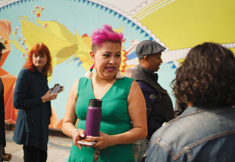 Galería de la Raza Executive Director, Ani Rivera, speaks to members of the press on Oct. 29. The iconic arts institution has been served with a  'three-day pay or quit' notice, placing the Galería at threat of displacement. Photo: George Eduardo Barahona