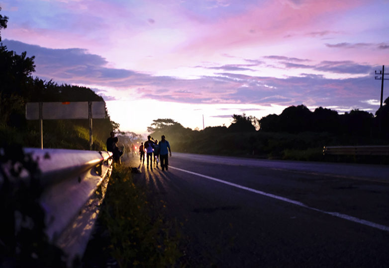 The sun rises as immigrants head out from Tapanatepec in route to Niltepec, Oaxaca. They begin walking around 3 a.m. to beat the heat of the sun as much as possible, Oct. 29, 2018. Courtesy: Jeff Valenzuela