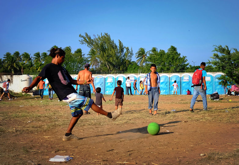 Central American migrants enjoy a game of fútbol on Oct. 31, 2018 in Juchitan, Oaxaca, Mexico. Courtesy: Jeff Valenzuela