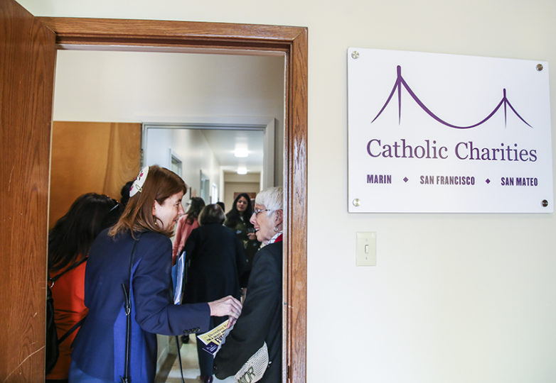 Senior Rabbi Beth Singer socializes with Sister Maire Sullivan at the Catholic Charities Mission Point location opening reception/blessing on Friday, Nov. 9 in San Francisco, Calif. (Photo: Adelyna Tirado)