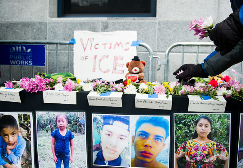Flowers and gifts are placed on the Victims of ICE memorial at Compassion Has No Walls, the monthly interfaith vigil for migrants and caravan members who have died while in detention. Photo: Beth LaBerge