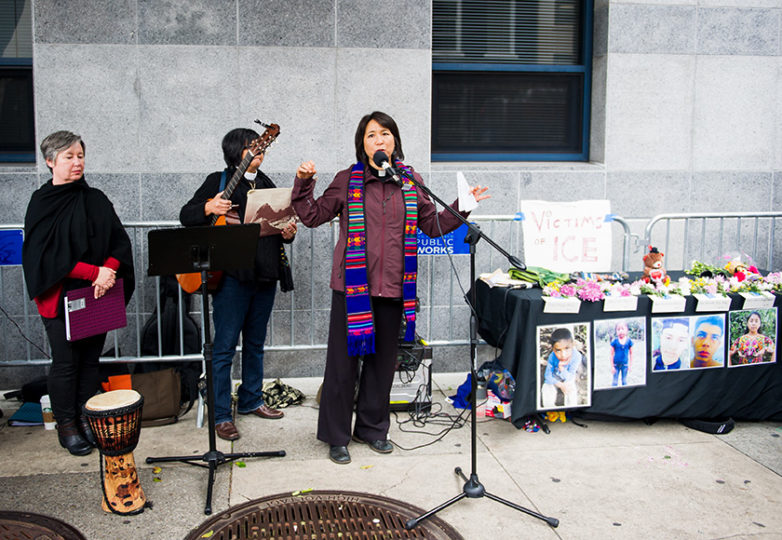 Rev. Deborah Lee (R) speaks at Compassion Has No Walls, the monthly interfaith vigil for migrants and caravan members who have died while in detention, which is held outside ICE's San Francisco headquarters at 630 Sansome St., Jan 11, 2019. Photo: Beth LaBerge