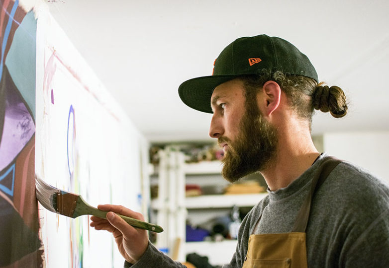 """In preparation for the gallery art show """"Castles Made of Fog,"""" artist Eli Lippert puts the final touches on his work """"The Divide"""" at his shared studio space in the Haight, Feb. 5, 2019. Photo: David Mamaril Horowitz"""