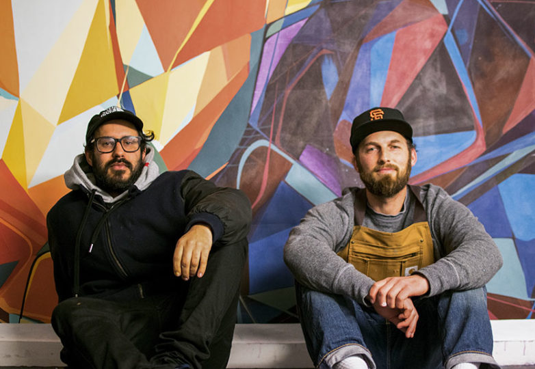 """Artists Max Marttila and Eli Lippert pose for the camera in their shared studio in the Haight on Feb. 5, 2019. The two friends' latest art show, """"Castles Made of Fog,"""" is currently on display in Acción Latina's Juan R. Fuentes Gallery. Photo: David Mamaril Horowitz"""