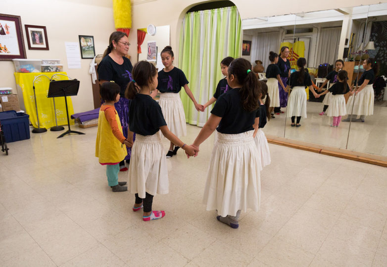 "Kumu (teacher) Lani Cid-Iulio teaches her Keiki students how to dance using Poi balls, at Island Hawaiian Studios in Alameda on Dec. 13, 2018. Cid-Iulio tells her students to ""practice."" Photo: Amanda Peterson"