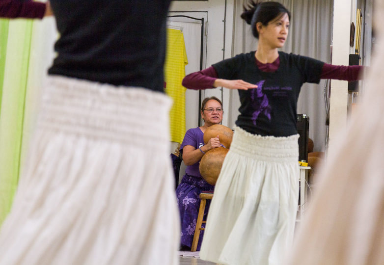 A student practices the Hula with Kumu Lani Cid-Iulio (background) the teacher and owner at Halau Makana, Island Hawaiian Studios in Alameda, Nov. 26, 2018. Photo: Amanda Peterson