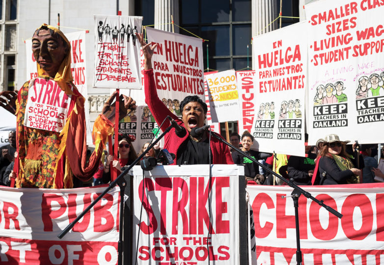 Becky Pringle, Vice President of National Education Association (NEA), rallies thousands of teacher and student protesters at Oscar Grant Plaza. Photo: Mike Chen