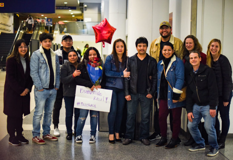 Friends and family of Raul Reyes Lopez pose in joy at Oakland International Airport. Photo: Alejandro Galicia Diaz