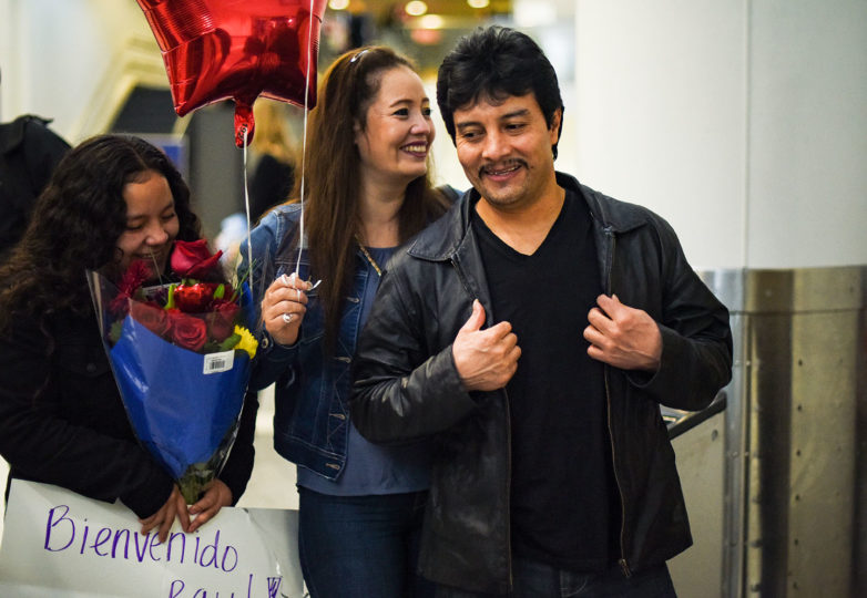 """Lopez stands with his daughter and his wife inside Oakland International Airport, after being released from two years of detention by ICE. """"I'm so happy, like the happiest person in the world,"""" Alexa said after her father's release. Photo: Alejandro Galicia Diaz"""