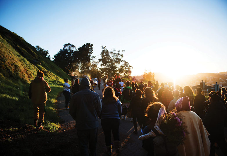 A crowd of friends and family of Alex Nieto walk to the future site of a permanent memorial for Nieto. They then held a moment of silence at the time of his death 5 years earlier, in Bernal Heights Park on Mar. 21, 2019. Photo: Beth LaBerge