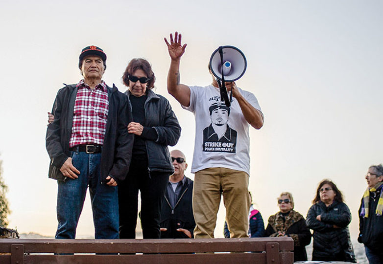 Refugio and Elvira Nieto, parents of Alex Nieto, Benjamin Bac Sierra (right) speak at the site of a future memorial for Nieto before a moment of silence on the 5 year anniversary of his death, in Bernal Heights Park on Mar. 21, 2019. Beth LaBerge