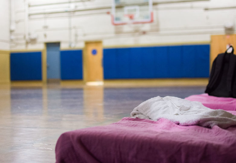 Two makeshift beds at Buena Vista Horace Mann K-8's smaller gym await the family of a student who would, if not for the school's overnight shelter program, be sleeping on the streets, March 8, 2019. Photo: David Mamaril Horowitz