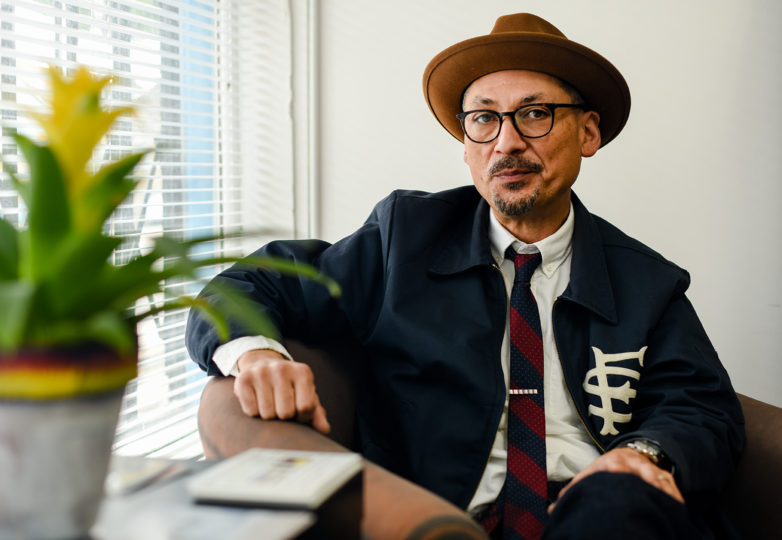Local artist and new executive director of Calle 24 Latino Cultural District Tomás Riley, poses for a portrait in the office's new home at the corner of 24th and Capp streets, March 6, 2019. Photo: Alejandro Galicia Diaz