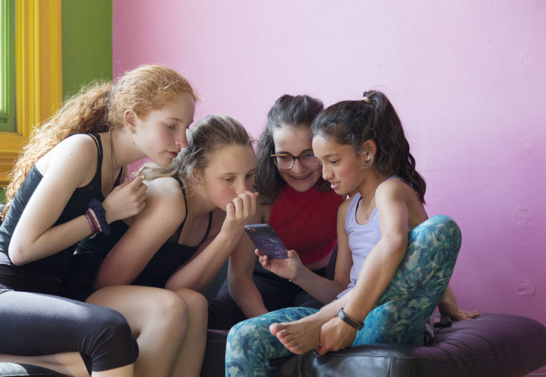 Girls chat during a break from dance rehearsal practice at Dance Mission Theatre on April 7, 2019. Photo: Amanda Peterson