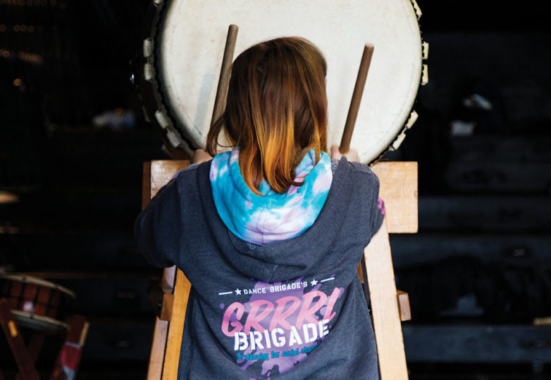 A student of Grrrl Brigade hits the Taiko drum during Taiko class at Mission Dance Theatre, April 2, 2019. Photo: Amanda Peterson