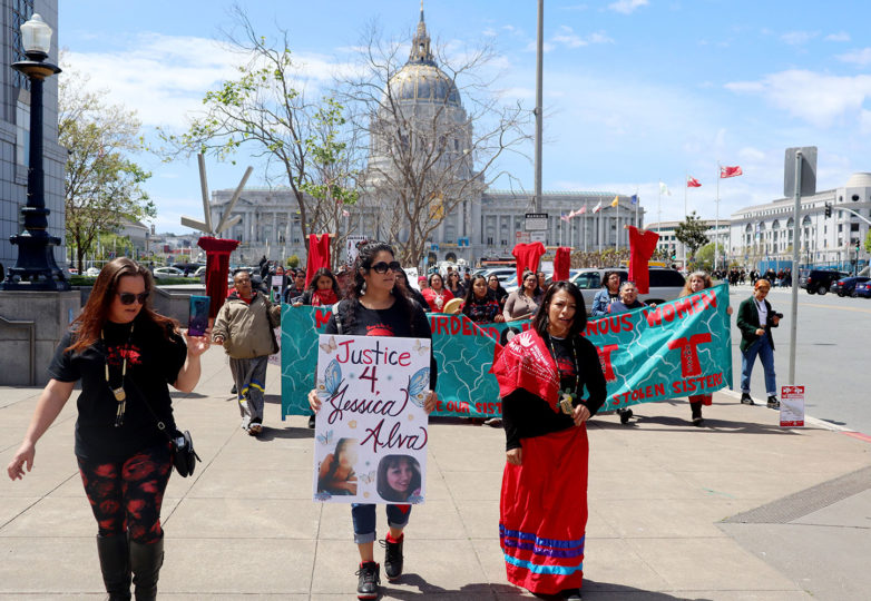 Demanding justice for Jessica Alva, a slain 35-year-old Indigenous woman, Alva's sisters, Sarah (center) and Marlena (right) lead a march from City Hall to the Pioneer Monument in San Francisco on April 16, 2019. Photo: Alexis Terrazas