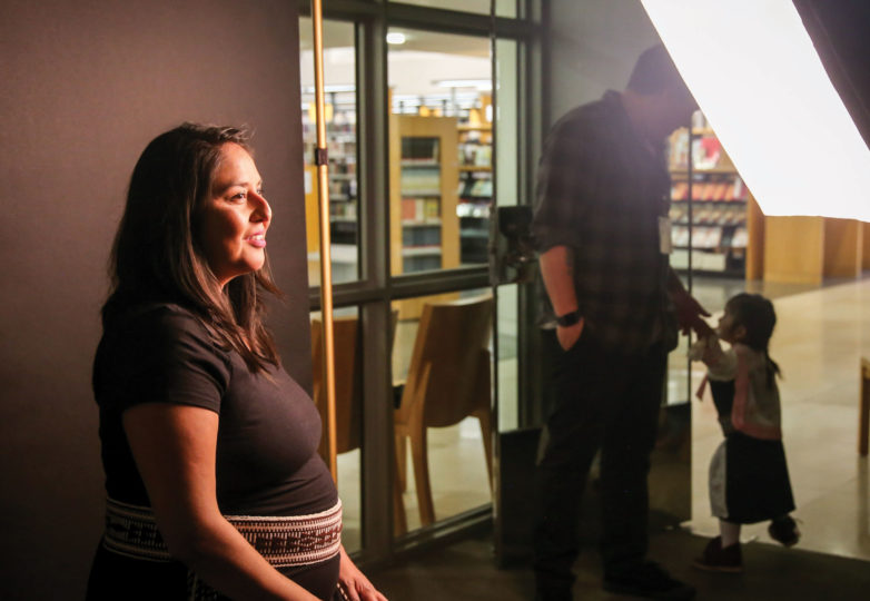 Executive Director of American Indian Film Institute Mytia Zavala gets photographed by Jean Melesaine inside the San Francisco Public Library for the Pioneer Monument Project on April 5, 2019. Photo: Adelyna Tirado