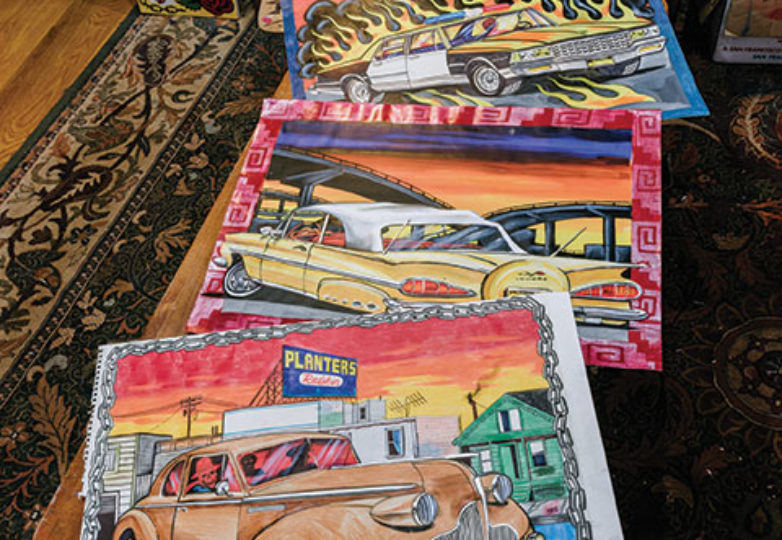 George Crampton-Glassanos' car paintings are displayed on his living room table inside of his studio in the Mission District, June 16, 2019. Photo: Mark Jason Quines
