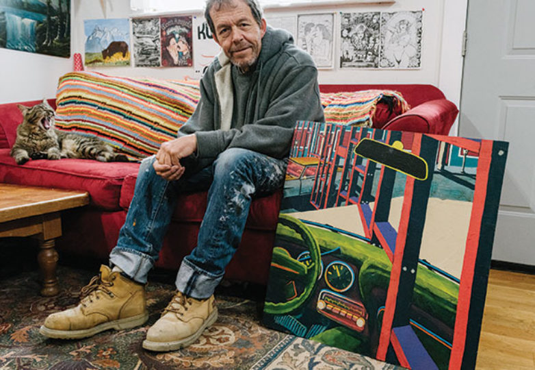 George Crampton poses for a portrait with one of his original paintings on June 16, 2019. Photo: Mark Jayson Quines