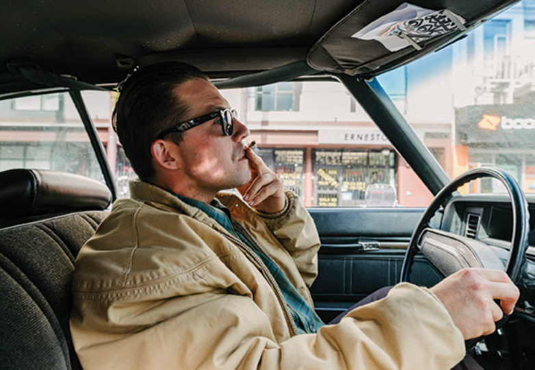 George Crampton-Glassanos smokes while driving around the Mission District, June 16, 2019. Photo: Mark Jayson Quines