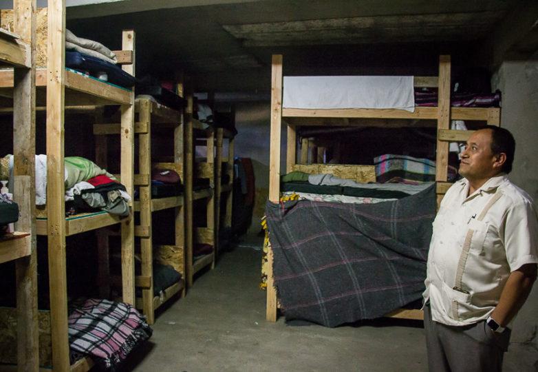 Pastor Jose Antonio Altamirano gives a tour of the men's sleeping area at Camino de Salvación church and shelter, Sunday March 10, 2019. Photo: Mabel Jiménez