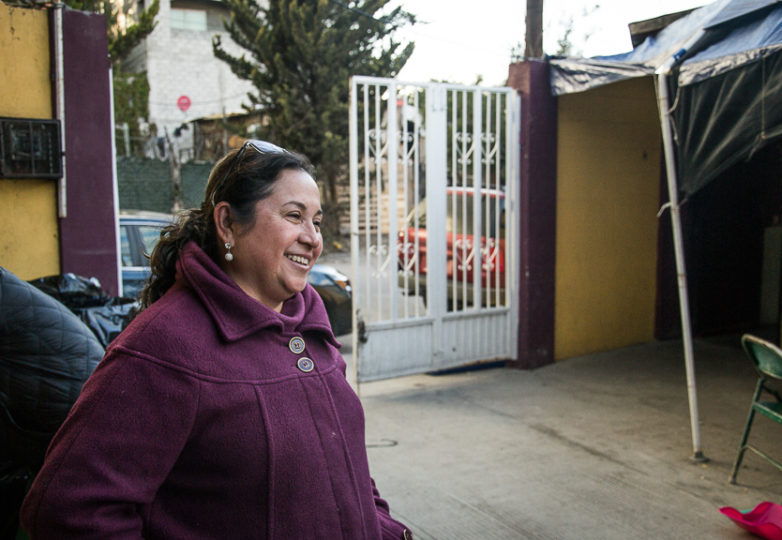 Pastor Adriana Reyes Galindo speaks to Melissa, a visiting volunteer, at the women and children's sleeping area at Camino de Salvación church and shelter, March 10, 2019. The church-turned shelter currently houses 75 people, more than twice its intended 35-person capacity. In response to an increase in need, sleeping areas were improvised inside the Temple. Mattresses laid on the floor are separated by using folding tables as short walls, and stacks of chairs hold the tables in place. During mass, the sleep area is put away so that chairs and tables can be used during sermon. Photo: Mabel Jiménez