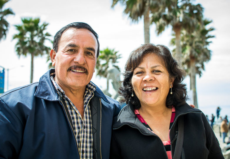 Braulio Mayer and Juana Castillo pose for a portrait near U.S.-Mexico border wall at Playas de Tijuana, Sunday March 10, 2019. Castillo, who lives in the US, met up in Tijuana with Mayer, her husband, who lives in Mexico City. They visited Tijuana so that Mayer, who cannot enter the United States, could visit his children and children from opposing sides of the US/Mexico border wall. Photo: Mabel Jiménez