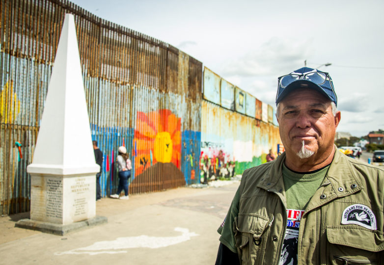Roberto Vivar poses for a portrait by the U.S.-Mexico border wall at Playas de Tijuana, Sunday March 10, 2019. Vivar was deported several years ago and now volunteers for Veterans for Peace, an organization that supports deported veterans.  Photo: Mabel Jiménez