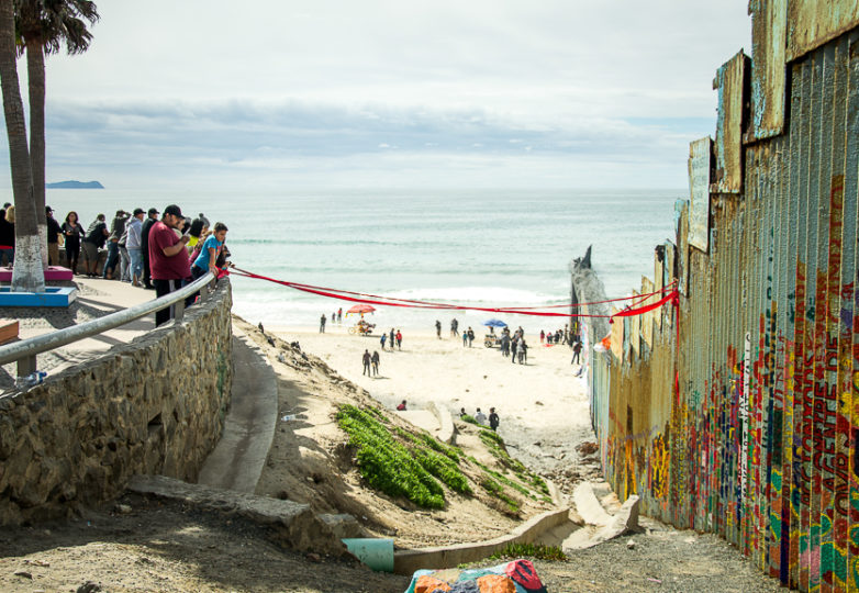 Visitors to Playas the Tijuana examine a red ribbon that was tied from the U.S.-Mexico border wall to an overlook structure in Playas de Tijuana Sunday March 10, 2019. Photo: Mabel Jiménez