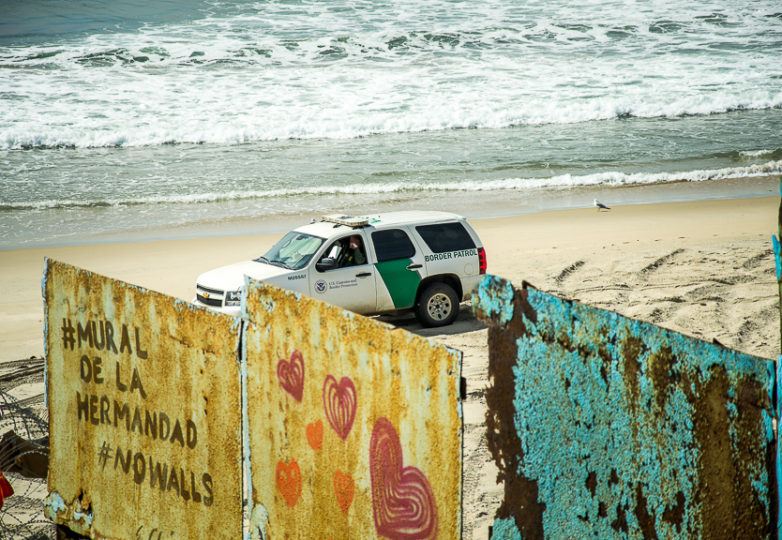 U.S. Border Patrol vehicles patrol the U.S.-Mexico border wall closely at Playas de Tijuana after receiving reports that a man was climbing the wall to tie red ribbon to the wall beams, Sunday March 10, 2019. Photo: Mabel Jiménez