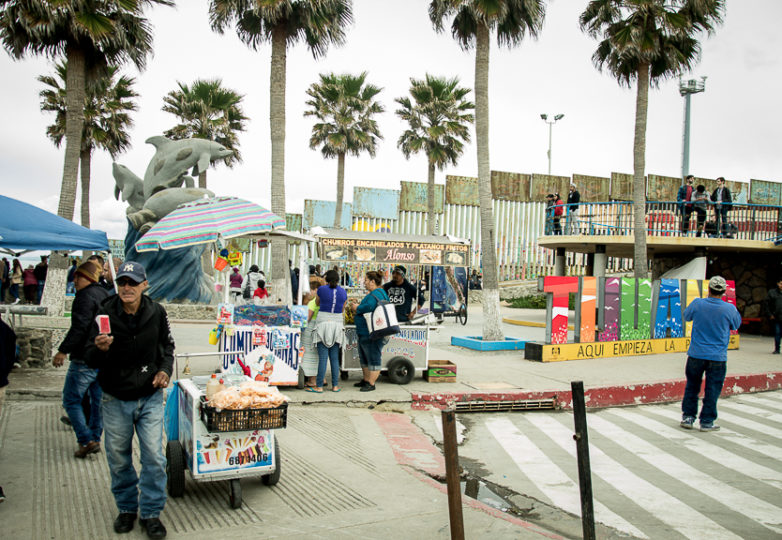 Food vendors stay busy during a weekly cross-border visit where families on both sides of the U.S.-Mexico border wall meet at Playas de Tijuana, Sunday March 10, 2019. Photo: Mabel Jiménez