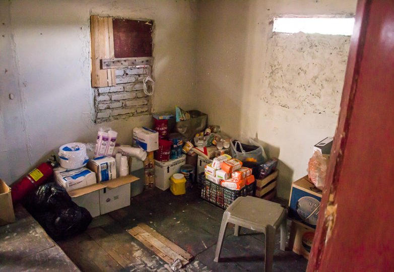Food donations are stored in a small room at Hotel Migrante's second floor.  A shelter for men who are deported or in transit, it has recently begun welcoming some families due to an increase of need for shelter space, Feb. 28, 2019. Photo: Mabel Jiménez