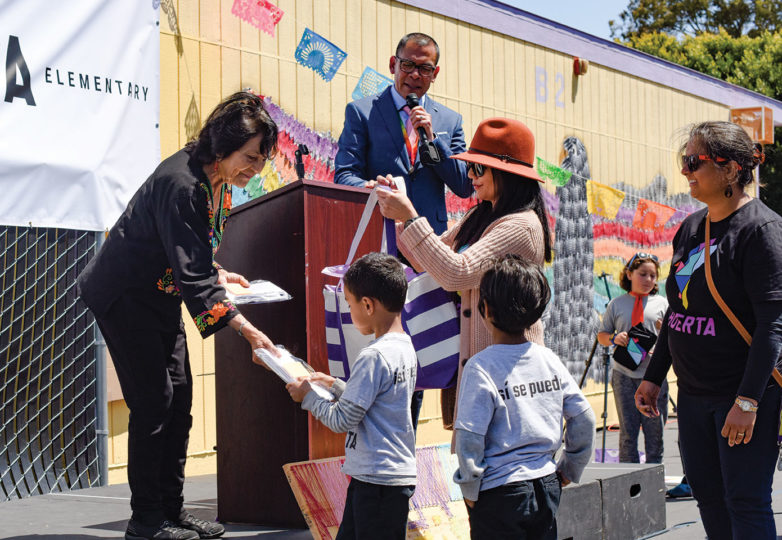 Labor leader and civil rights activist Dolores Huerta receives gifts from students on May 17, during a celebration of the elementary school being renamed in her honor. 2019. Photo: Alejandro Galicia Diaz