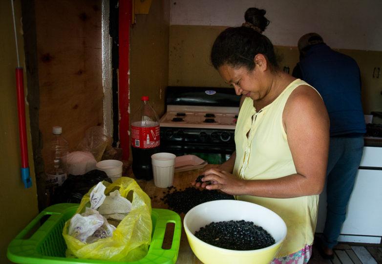 Migrants arriving with a recent caravan prepare a meal at Casa de Luz, a new LGBT friendly migrant shelter on Monday March 11, 2019.  Photo: Mabel Jiménez