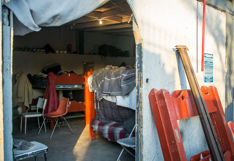 The male sleeping quarters are near the entrance gates at Roca de Salvacion shelter, one of the most remote migrant shelters in Tijuana, located at the foot of El Cerro Colorado mountain, in the Cañón de la Raza neighborhood. March 14, 2019. Photo: Mabel Jiménez