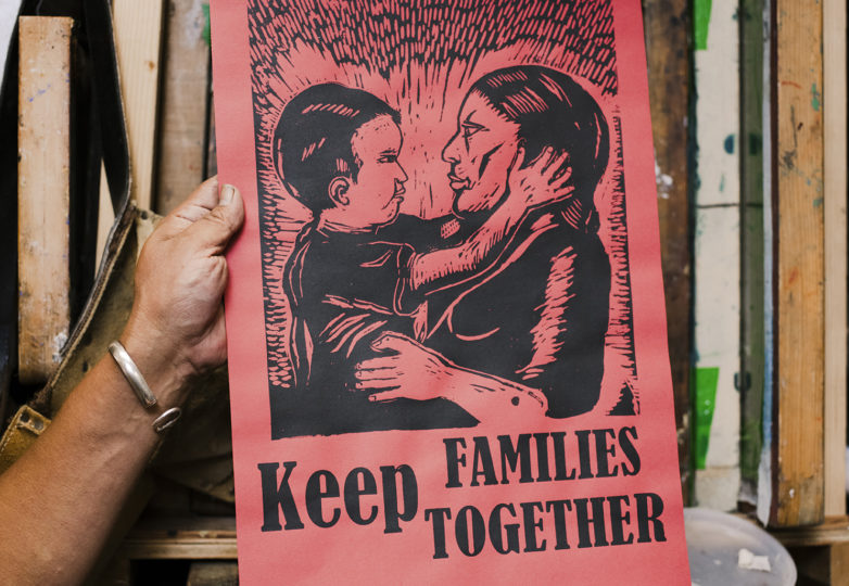 "Txutxo Perez in his studio at the Redstone Building in the Mission District, holding a ""Keep Families Together"" silkscreen print, June 16, 2019. Photo: Dane Pollok"