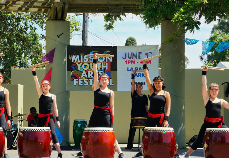 Girls beat taiko drums during their performance with Grrl Brigade on Sunday, June 9, 2019.