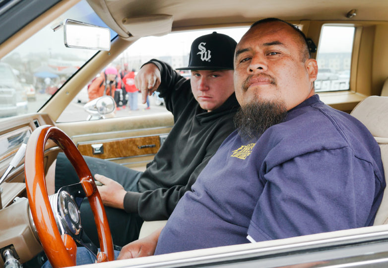 Participants in the King of the Streets contest pose for a portrait in their lowrider at City College of San Francisco on July 13, 2019. Photo: Iván Hernández
